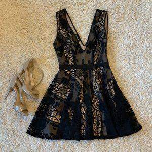 Black & Nude Lace Deep Cut BEBE Dress